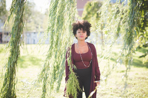 beautiful black curly hair african woman in town