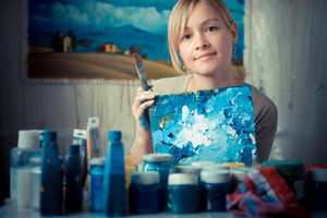 beautiful blonde woman painter in her studio