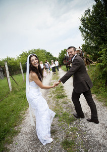 Beautiful bride and groom at country style wedding