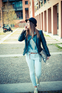 beautiful brunette young woman in the city