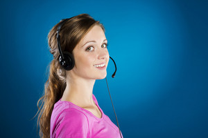 Beautiful call center young woman is ready for business support
