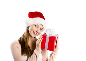 Beautiful christmas woman is holding red gift in studio