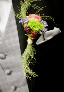 Beautiful floral wedding floral decoration at groom suit