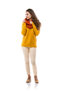 Beautiful girl in autumn clothes posing in studio, isolated on white background