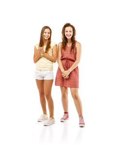 Beautiful girls laughing together, isolated on white background. Best friends