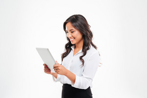 Beautiful happy asian businesswoman using tablet computer isolated on a white background