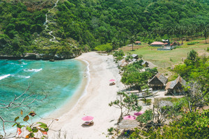 Beautiful idyllic white sand Atuh beach appealing for relax. Clear blue ocean waves rolling to the beach. Nusa Penida, Bali, Indonesia