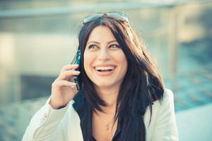beautiful long black hair elegant business woman in the city