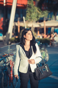 beautiful long black hair elegant business woman in the city