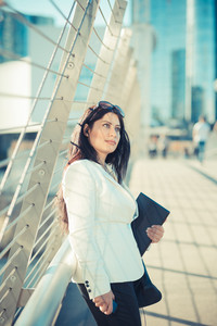 beautiful long black hair elegant business woman with tablet  in the city