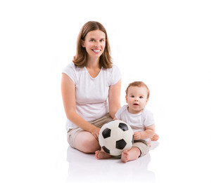Beautiful mother with her son. Studio shot on white background.
