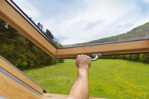 Beautiful nature view through roof skylight window in attic room.