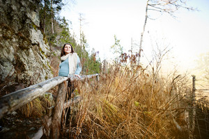 Beautiful outdoor pregnant woman portrait in autumn nature