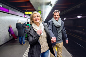 Beautiful senior couple at the underground platform, waiting
