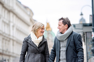 Beautiful senior couple on a walk in historical centre of the city of Vienna, Austria. Winter.