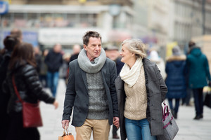 Beautiful senior couple shopping in historical centre of the city of Vienna, Austria. Winter.