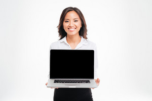 Beautiful smiling asian businesswoman showing laptop with blank screen isolated on the white background