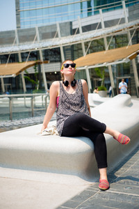 beautiful stylish modern young woman in the city