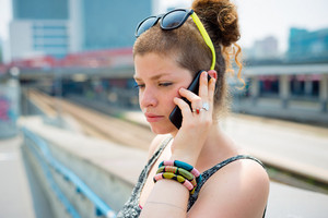 beautiful stylish modern young woman on the phone in the city