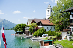Beautiful summer Alpine town and Alpine lake view in Austria