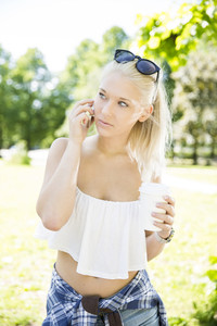Beautiful teenage girl talking in the phone