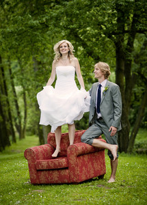 Beautiful wedding couple is having fun outside