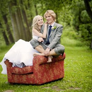 Beautiful wedding couple is having fun outside