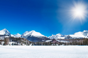 Beautiful winter mountain landscape with sun. High Tatras, Slovakia.