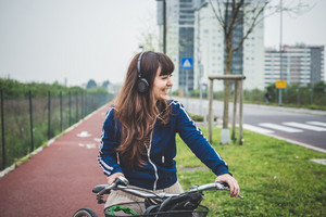 beautiful woman biker cycling in a desolate lurban landscape