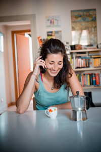 beautiful woman calling during breakfast at home