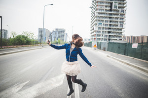 beautiful woman dancing in a desolate lurban landscape