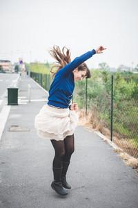 beautiful woman dancing in a desolate lurban landscape