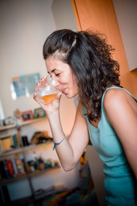 beautiful woman drinking beer at home
