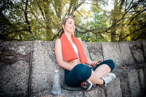 beautiful woman fitness listening to music at the park