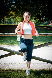 beautiful woman fitness relaxing after sport at the park
