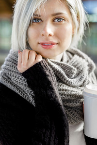 Beautiful Woman Holding Disposable Coffee Cup At Train Station