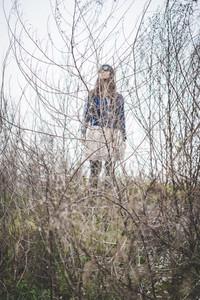 beautiful woman in a desolate lurban landscape