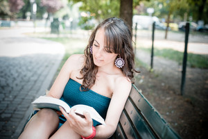 beautiful woman reading book in the city