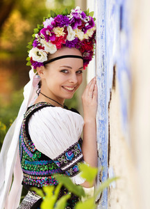 Beautiful woman wearing traditional Eastern Europe folk costumes.
