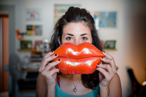 beautiful woman with big mouth smiling at home