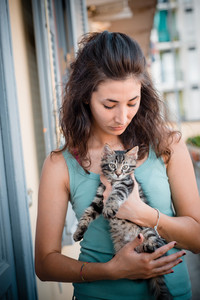 beautiful woman with cats at home