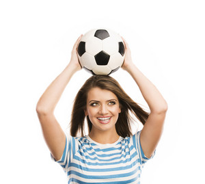 Beautiful woman with soccer ball isolated on white background
