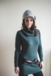 beautiful woman with turtleneck, cap and belt autumn  on white background