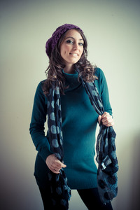 beautiful woman with turtleneck, scarf and cap autumn on white background
