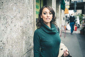 beautiful woman with turtleneck walking in the city autumn