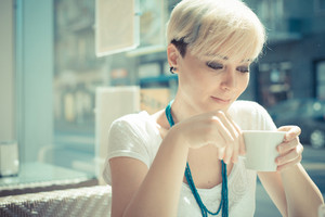 beautiful young blonde short hair hipster woman at the cafe