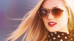Beautiful young blonde woman in a sunglasses with grid concept