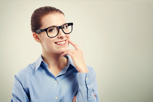 Beautiful young business woman wearing big black eyeglasses