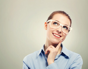 Beautiful young business woman wearing white eyeglasses thinking