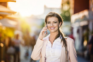 Beautiful young business woman with smart phone